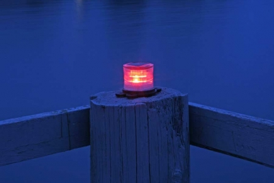 Picture of red marine solar light at night.