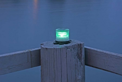 Picture of green marine solar light at night.
