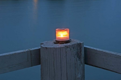 Picture of orange marine solar light at night.
