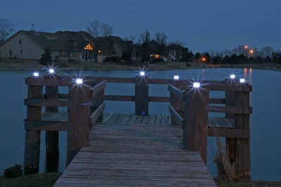 Picture at night of an installation with several marine solar lights.