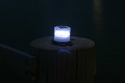 Closeup picture of clear marine solar light at night.