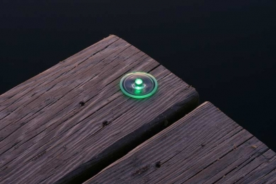 Picture of small solar dock dot light installed.