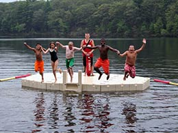 Picture of kids jumping off an EZ Dock swim platform